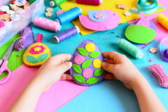 Kid holds Easter egg decor in his hands. Small kid shows his Easter crafts Royalty Free Stock Photography