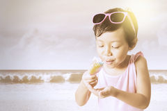 Kid holds a melted ice cream Royalty Free Stock Photography