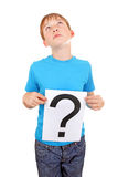 Kid holds Question Mark Royalty Free Stock Images