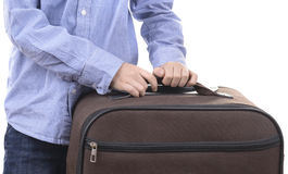 Kid holds suitcase Royalty Free Stock Photo