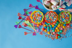 Kid holiday decoration. Colored candy on blue background Royalty Free Stock Images