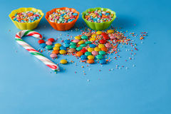 Kid holiday decoration. Colored candy on blue background Royalty Free Stock Image