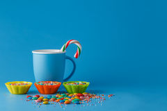 Kid holiday decoration. Colored candy on blue background Stock Photography