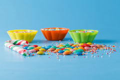 Kid holiday decoration. Colored candy on blue background Stock Image