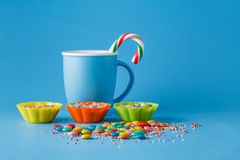Kid holiday decoration. Colored candy on blue background Stock Photos