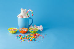 Kid holiday decoration. Colored candy on blue background Royalty Free Stock Photography