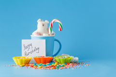 Kid holiday decoration. Colored candy on blue background Stock Images