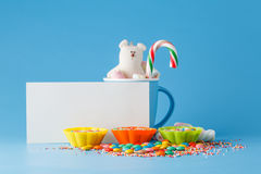 Kid holiday decoration. Colored candy on blue background Royalty Free Stock Photo