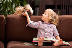 Kid at home playing Royalty Free Stock Images