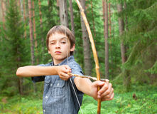 Kid with homemade bow and arrow Stock Photography