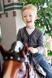 Kid at the horse Stock Photo