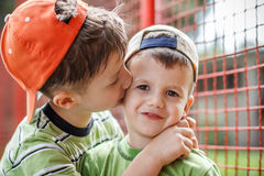 Kid hug his little brother Stock Photo