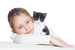 Kid hugging kitten Royalty Free Stock Photo