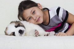 Kid hugging a puppy Stock Image