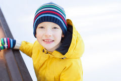 Kid ice skating. Little boy enjoying cold winter weather and ice skating at outdoor rink Stock Photo