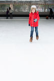 Kid ice skating. Positive happy boy enjoying winter vacation at outdoor ice skating rink learning ice skating Stock Photos