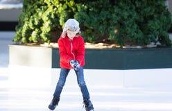 Kid ice skating Stock Image