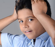 Kid. Indian kid with expression in the face Royalty Free Stock Images