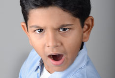 Kid. Indian kid with expression in the face Royalty Free Stock Photo