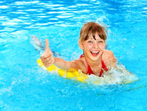 Kid  on inflatable ring thumb up. Stock Photography