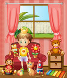 A kid inside the house with his toys Stock Photography