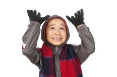 Kid in jacket looking up. Boy in cold weather clothes looking up with hands raised, smiling, isolated on white background Stock Photos