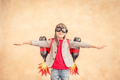 Kid playing with jet pack at home Stock Photos