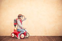 Kid with jet pack playing at home. Kid with jet pack. Child playing at home. Success, imagination and innovation technology concept Stock Photos