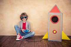 Kid with jet pack playing at home Stock Photo