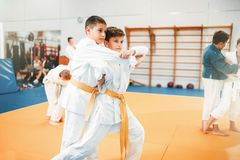 Kid judo, childrens training martial art in hall. Little boys in uniform, young fighters royalty free stock image