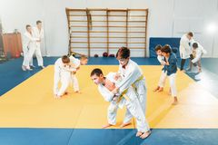 Kid judo, childrens training, self-defense. Kid judo, childrens training martial art, self-defense. Little boys in uniform in sport gym, young fighters royalty free stock photo