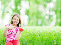 Kid and juice Royalty Free Stock Photo