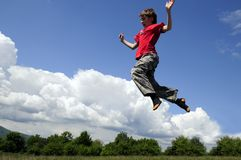 Kid jumping Stock Photo