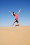 Kid jumping in the desert Stock Photos