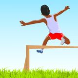 Kid jumping fence Royalty Free Stock Images