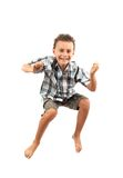 Kid jumping for joy. Gorgeous kid jumping for joy, isolated on white background Stock Images