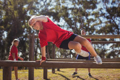 Kid jumping over the hurdles during obstacle course training. Kids jumping over the hurdles during obstacle course training in the boot camp Stock Photos