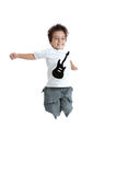 Kid jumping with a tshirt with a guitar painted Royalty Free Stock Photo