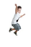 Kid jumping with a tshirt with a guitar painted Royalty Free Stock Images