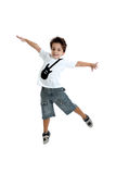 Kid jumping with a tshirt with a guitar painted Royalty Free Stock Photos