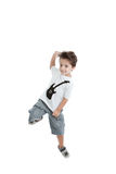Kid jumping with a tshirt with a guitar painted Stock Photo