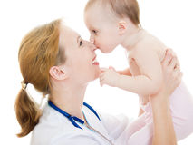 Kid kisses the doctor Stock Photo
