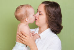 The kid kisses the mum Royalty Free Stock Photo