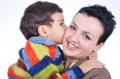 A kid kissing his mother Royalty Free Stock Image