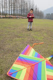 Kid with kite Stock Photography