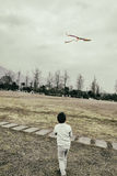 Kid flying kite Royalty Free Stock Images
