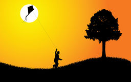 Kid with Kite At Sunset Royalty Free Stock Image