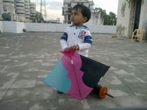 Kid with kite and thread on Kite flying day, Ahmedabad Stock Image