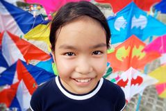 Kid kites. Image of smiling kid with colorful kite background Stock Photography