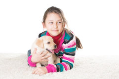 Kid and labrador puppy Royalty Free Stock Images